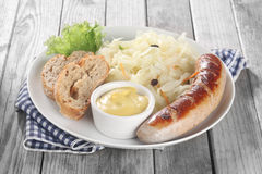 Veggies and Sausage on Plate with Bread and Sauce Royalty Free Stock Photos