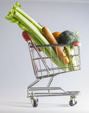 Veggies in a shopping cart Stock Images