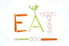 Veggies spell eat. Stock Photo