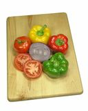 Veggies on Wood. Assorted vegetables on wood cutting board Royalty Free Stock Images