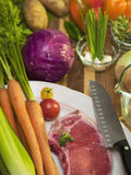Vegitables and steak on a cutting board Royalty Free Stock Images