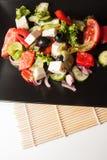 Vegrtables en salade de plat noir Photo libre de droits