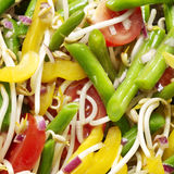 Vegtables salad with tomato, beans, yellow pepper, bean sprouts. And red union closeup shot royalty free stock photos