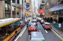 Vehículo y tráfico de la calle en Hong-Kong Fotos de archivo