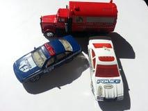 Vehículos policiales del juguete en el fondo blanco Fotografía de archivo