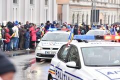 Vehículos policiales en un evento nacional Fotografía de archivo