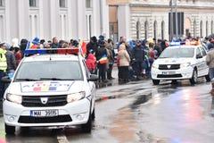 Vehículos policiales en un evento nacional Imagenes de archivo