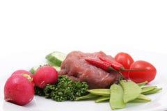 Vehículos y carne sin procesar Foto de archivo libre de regalías