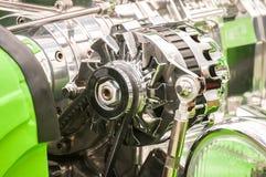 Vehicle alternator. Chromed vehicle alternator in a hot-rod engine bay royalty free stock image
