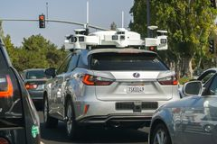 Vehicle from Apple`s fleet currently testing a self driving syst royalty free stock image