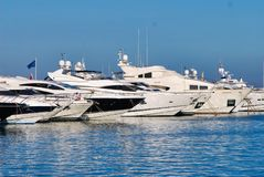 Vehicle, boat, ship, passenger ship, luxury yacht, marina, yacht. Vehicle is boat, luxury yacht and dock. That marvel has ship, marina and watercraft and that stock photos