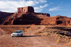 Vehicle at the Bottom of Dead Horse Point. Shafer Trail Road and Mineral Road provide access from the main scenic drive atop the Island in the Sky mesa of Stock Photography