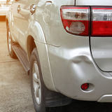 Vehicle car bumper dent and taillight broken collision crash Stock Image