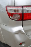 Vehicle car bumper dent and taillight broken collision crash. Damage accident on road Royalty Free Stock Image