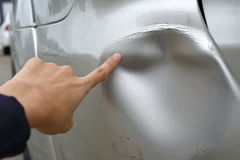 Vehicle car bumper dented broken from collision crash damage. Sufferer hand point of vehicle car bumper dented broken from collision crash damage accident on Stock Photos