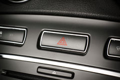 Vehicle, car hazard warning flashers button with visible red tri. Button of vehicle, car hazard warning flashers button with visible red triangle, visible stock photos