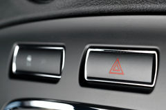 Vehicle, car hazard warning flashers button with visible red tri. Button of vehicle, car hazard warning flashers button with visible red triangle, visible royalty free stock images