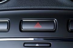 Vehicle, car hazard warning flashers button with visible red tri. Button of vehicle, car hazard warning flashers button with visible red triangle, visible royalty free stock photos