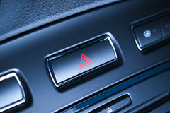 Vehicle, car hazard warning flashers button with visible red triangle. Button of vehicle, car hazard warning flashers button with visible red triangle, visible royalty free stock photos