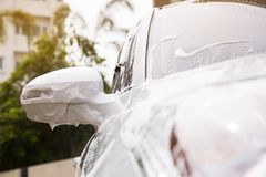 Vehicle condition being washed, white car. Stock Photos