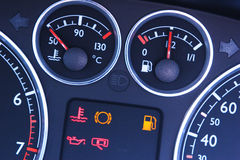 Vehicle Dashboard Gauges. A closeup on the dashboard of a modern car with focus on the temperature and fuel indicators Stock Images
