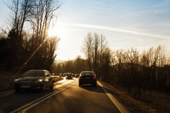 Vehicle driving fast on country road Stock Images