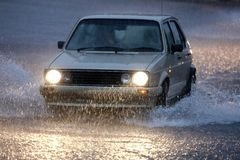 Vehicle Driving in Heavy Rain Stock Images