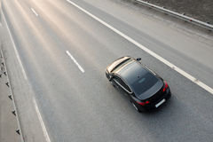 Vehicle Driving On Highway. Under evening light in right lane Stock Image