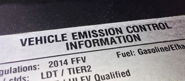 Vehicle Emission Control. The Vehicle emissions information tag in the engine compartment of a motor vehicle Stock Photo