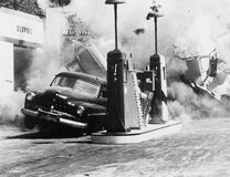 Vehicle exploding at gas station. (All persons depicted are no longer living and no estate exists. Supplier grants that there will be no model release issues royalty free stock photography