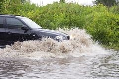 Vehicle in flood Royalty Free Stock Photos