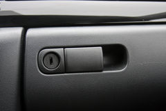 Vehicle glove compartment. A photo of a vehicle's glove compartment with focus on the lock Stock Photo