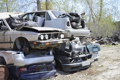 A vehicle graveyard - cars piled on top of each other stock image