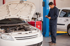 Vehicle inspection at an auto shop Stock Photo