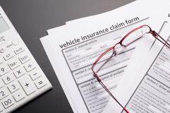 Vehicle Insurance Policy. With car keys on gray table Royalty Free Stock Images