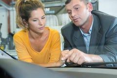 Vehicle insurance representative inspecting crack on windshield royalty free stock photos