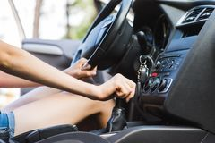 Gear lever in car with female driver royalty free stock images