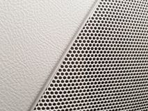 Vehicle interior styling - car audio system speaker. Car interior styling, showing detail of speaker grille - pebbled leather look stock image