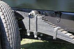 Vehicle leaf spring. Photo of vehicle leaf spring closeup Royalty Free Stock Image