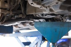 vehicle lift up by hydraulic for engine oil change and transmiss Royalty Free Stock Photo