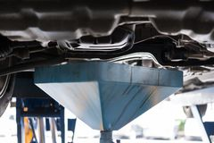 vehicle lift up by hydraulic for engine oil change and transmiss Stock Photos