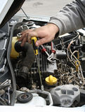 Vehicle maintenance. Hand with screwdriver inspecting and searching for problems Stock Image