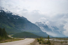 Vehicle moving on winding scenic Icefields parkway Stock Photo
