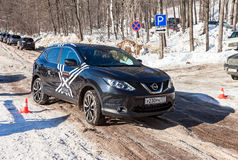Vehicle Nissan Pathfinder moving  in sunny day on the rural road. SAMARA, RUSSIA - FEBRUARY 14, 2016: Vehicle Nissan Pathfinder moving  in sunny day on the rural Royalty Free Stock Photo
