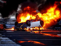A vehicle overturned in flames Stock Photo