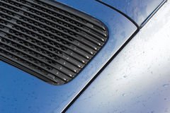 Vehicle panel raindrops. Raindrops on a vehicle panel and grille Royalty Free Stock Photo