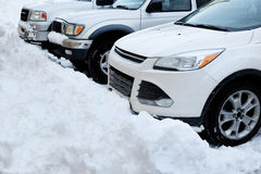 Vehicle Parked in Snow Banks Winter Snowy Stock Photo