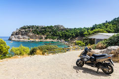 Vehicle parking in front to Anthony Quinn sea bay Royalty Free Stock Photography