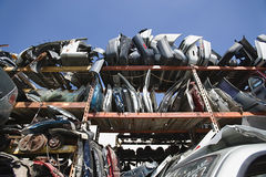 Vehicle Parts In Junkyard. Low angle view of scrapped vehicle parts in junkyard Stock Photography