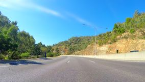 Driving along Adelaide freeway to Adelaide Hills, South Australia. Vehicle POV, driving along Adelaide freeway to Stirling, Adelaide Hills, South Australia royalty free stock photo